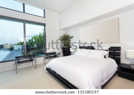 Modern bedroom in luxury apartment - stock photo