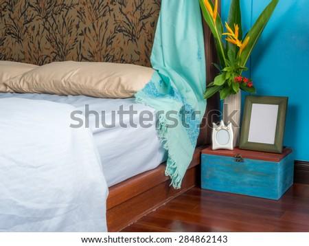 Modern bedroom interior design with flower vase - stock photo
