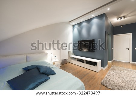 Modern bedroom interior in loft apartment