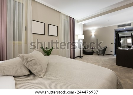Modern bedroom interior in the evening  - stock photo