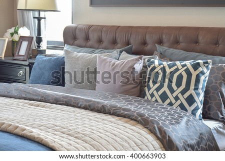 modern bedroom interior with colorful pillow on bed at home - stock photo