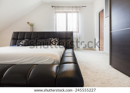 Modern bedroom interior with luxury double bed - stock photo
