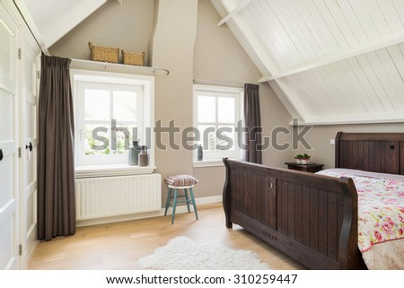 Modern bedroom interior with wooden floor and ceiling - stock photo