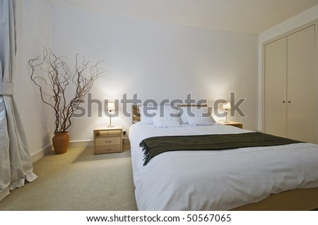 modern bedroom of a generous size with built in wardrobe - stock photo