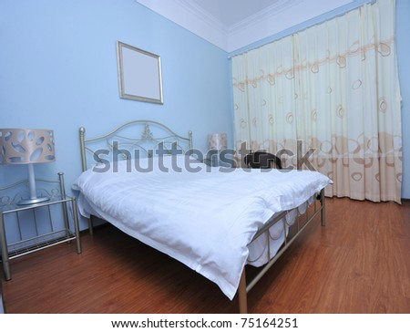 modern bedroom with a double bed. - stock photo