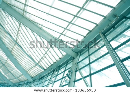 modern blue glass wall of office buildings - stock photo