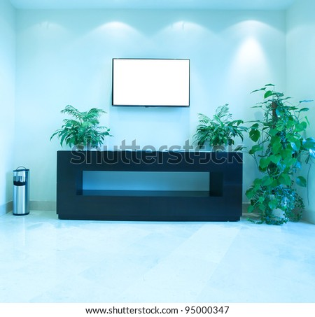 modern blue light hall with empty placard on the wall - stock photo
