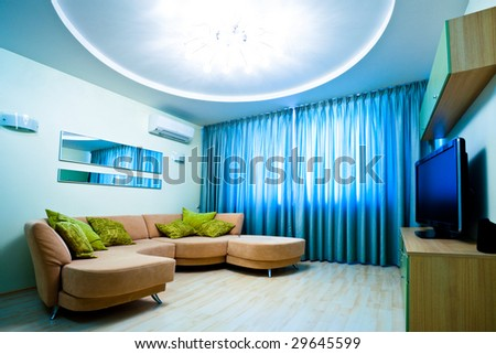 Modern blue room interior with TV and sofa - stock photo