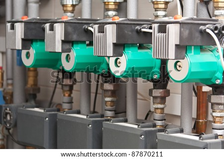 Modern boiler room equipment for heating system. Pipelines, water pump, manometers. - stock photo