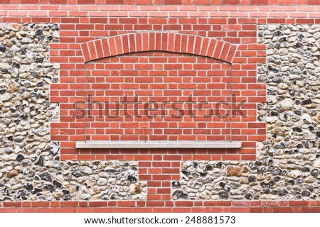 Modern brick pattern an an old stone wall - stock photo