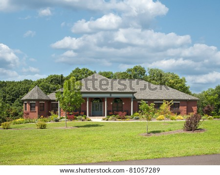 Modern brick single story farm house in USA. - stock photo