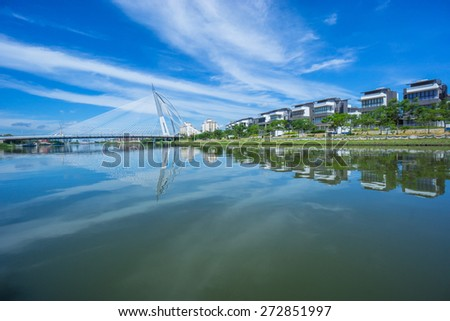 Modern bridge and the building at Putrajaya, Kuala Lumpur, during sunny day with beautiful reflection - stock photo