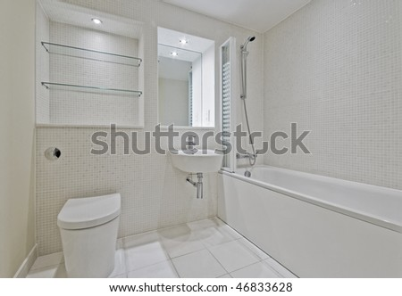 modern bright bathroom with beige mosaic tiles - stock photo