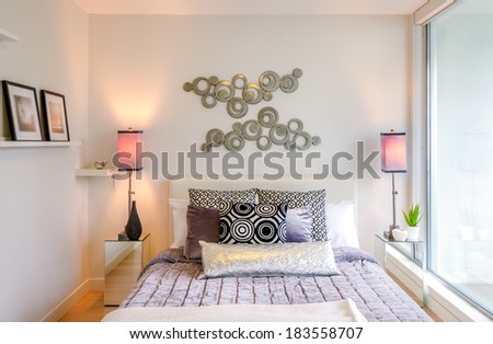 Modern bright bedroom interior with designer pillows in a luxury house - stock photo