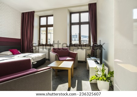 Modern,bright hotel room with violet theme - stock photo
