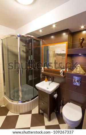 Modern brown bathroom interior - stock photo