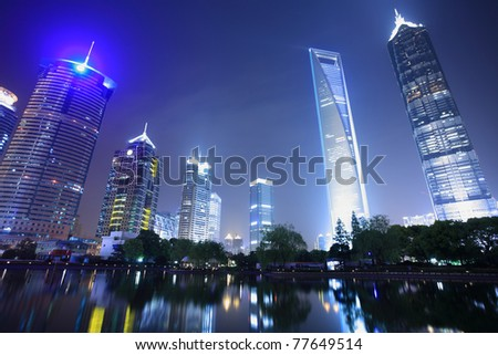 modern building at night in shanghai - stock photo