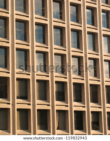 Modern building detail out of glass and cement - stock photo