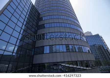 modern building exterior, latticed glass windows and reflected cityscape - stock photo
