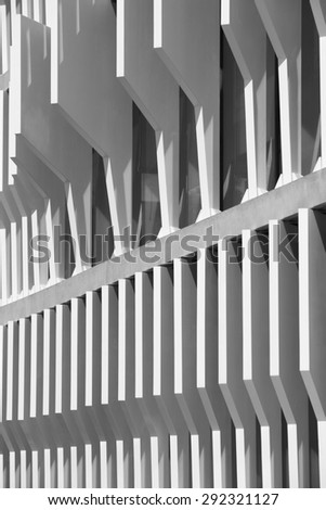 Modern building facade structure detail in black and white. Vertical - stock photo