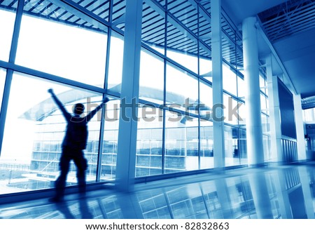 Modern building interior, Shanghai Pudong Airport Terminal window of the man. - stock photo