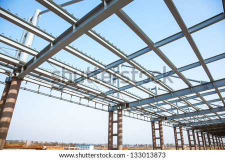 modern building roof under blue sky - stock photo