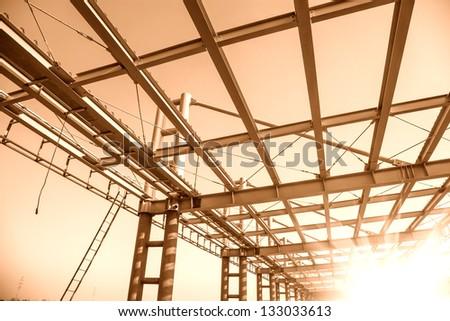 modern building roof under blue sky - stock photo