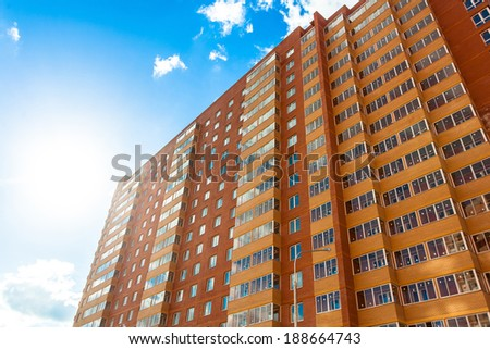 Modern building wall, red and yellow perspective view - stock photo