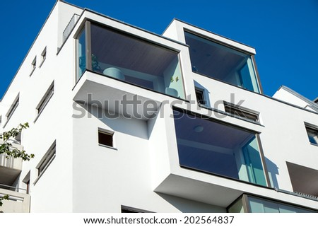 Modern building with big windows seen in Berlin, Germany - stock photo