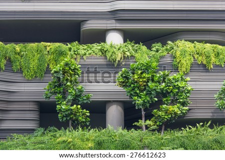 Modern building with plants - stock photo