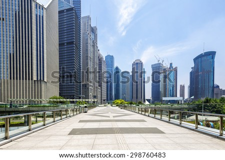 Modern buildings and urban road in city - stock photo