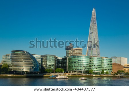 Modern buildings by river Thames in London - stock photo