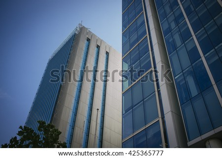 modern buildings going up towards the sky - stock photo