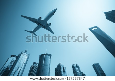 modern buildings skyline with airplane in shanghai financial center - stock photo
