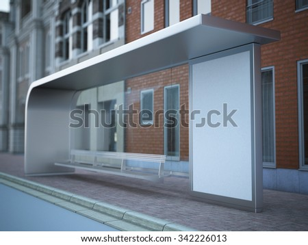 Modern bus stop with blank billboard near brick wall. - stock photo