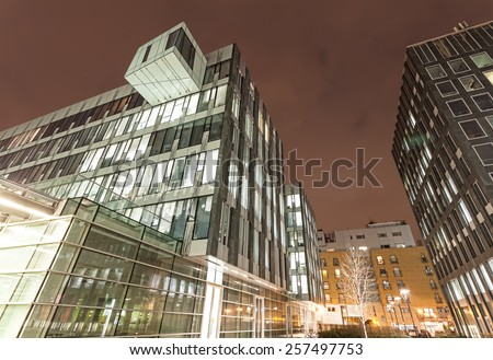 Modern business center in Warsaw at night. - stock photo