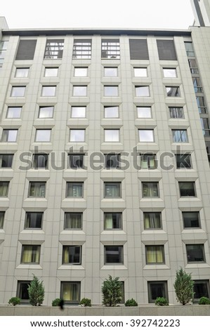 modern business center, lots of windows, gray building - stock photo