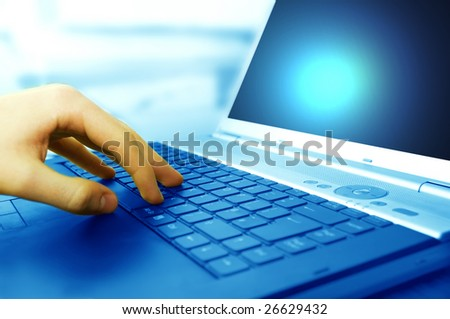 Modern business equipment. Typing on keyboard - stock photo