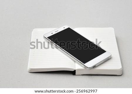 Modern business on the go-  Smart phone and notebook isolated - stock photo