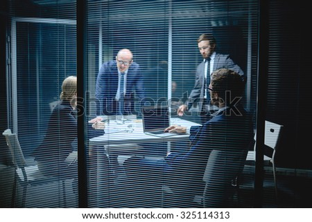 Modern business people having meeting in office - stock photo