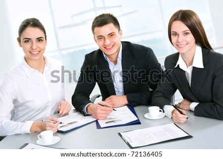 Modern business people work at a seminar - stock photo