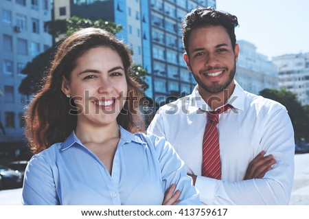 Modern business team outdoor in cool cinema look - stock photo