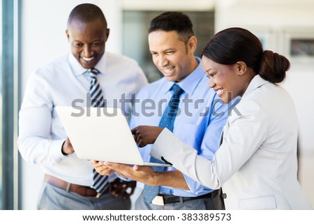 modern business team using laptop computer in office - stock photo