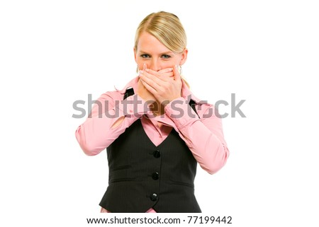 Modern business woman making speak no evil gesture isolated on white - stock photo