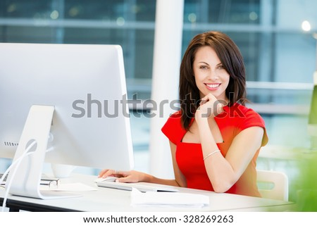 Modern business woman working on computer - stock photo