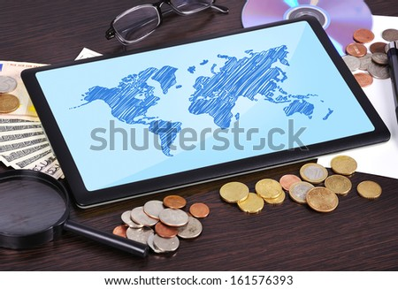 Modern business workplace: tablet with world map - stock photo