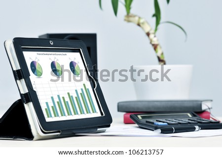 Modern business workplace with digital tablet, calculator, pen - stock photo