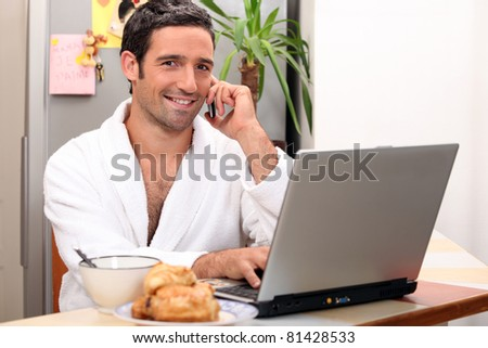 modern businessman having breakfast at home - stock photo