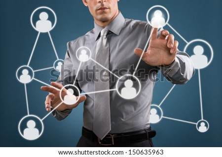 Modern businessman touch a digital screen for business social networking - stock photo