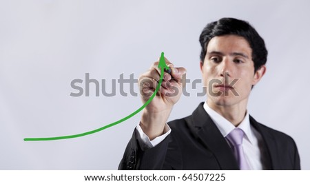Modern businessman writing the business stats progress in the whiteboard (selective focus) - stock photo